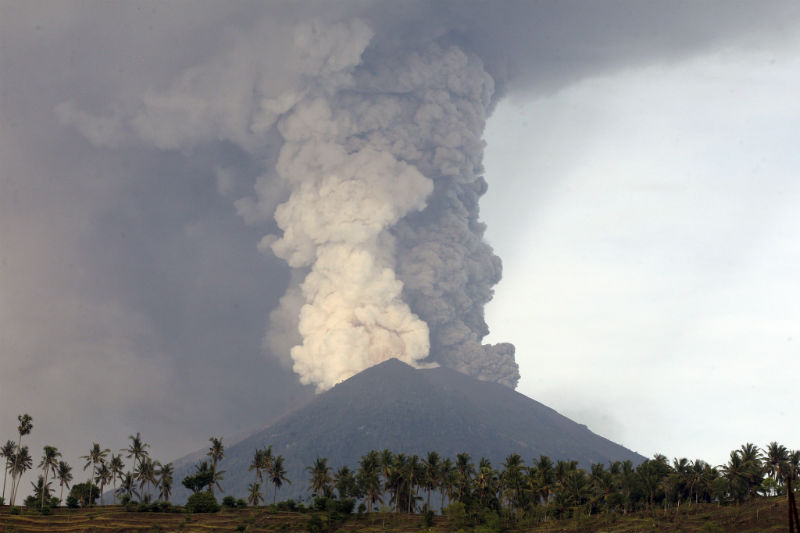 Tens of thousands stranded as Bali volcano closes airport